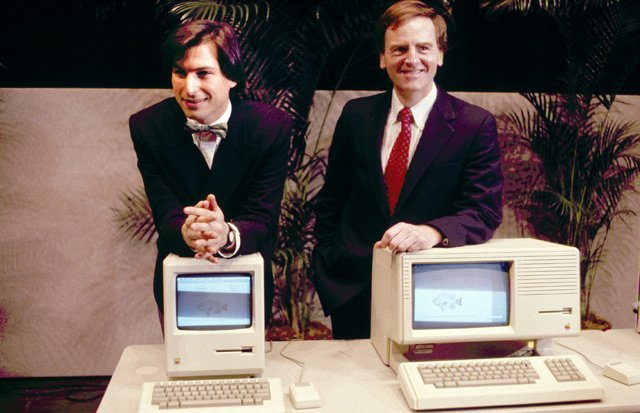 Apple CEO Steven P. Jobs, left and President John Sculley present the new Macintosh Desktop Computer in January 1984 at a shareholder meeting in Cupertino, California, USA. (AP Photo)