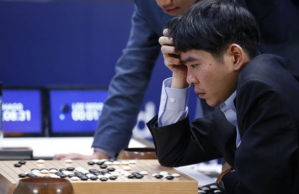 South Korean professional Go player Lee Sedol reviews the match after finishing the third match of the Google DeepMind Challenge Match against Google's artificial intelligence program, AlphaGo, in Seoul, South Korea, Saturday, March 12, 2016. Google's Go-playing software defeated a human champion for the third straight time Saturday to clinch the best-of-five series and establish its superiority in an ancient Chinese game long thought to be the realm of humans. (AP Photo/Lee Jin-man)