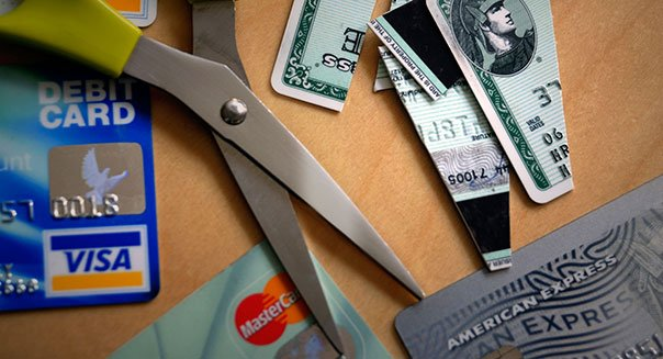 ANJ67M Cutting up credit cards. Image shot 2008. Exact date unknown.
