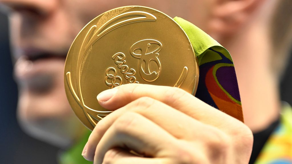 United States' Ryan Murphy shows off his gold medal after the medal ceremony for the men's 200-meter backstroke final during the swimming competitions at the 2016 Summer Olympics, Thursday, Aug. 11, 2016, in Rio de Janeiro, Brazil. (AP Photo/Martin Meissner)